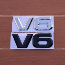 Эмблема V6