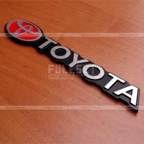 Декоративная надпись Toyota, матовый хром на черном фоне (размер: 15,5 см на 2 см)