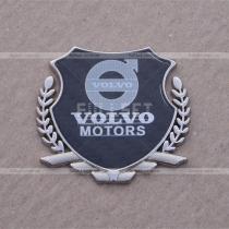 Эмблема герб Volvo на карбоновом фоне