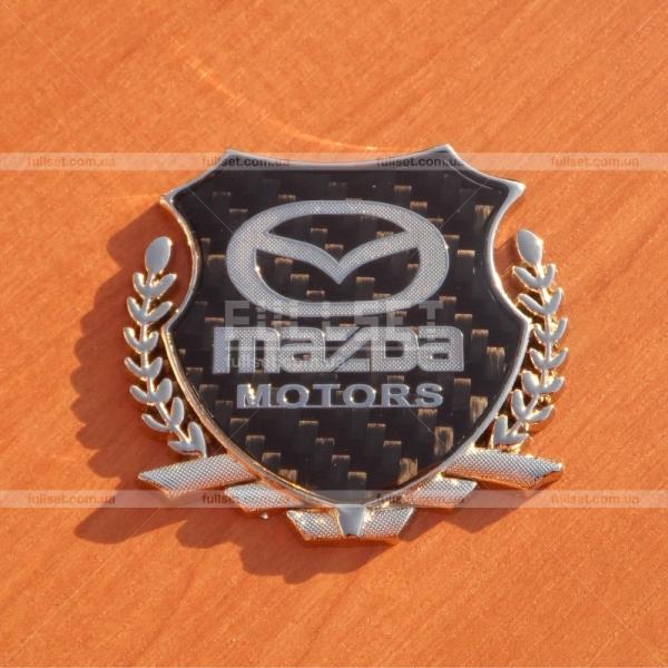 Эмблема герб Мазда