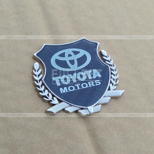 Эмблема-герб Toyota